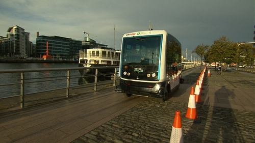 The EZ10 shuttle makes its way alongside the Liffey