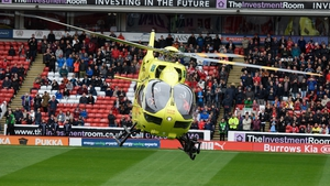 An air ambulance lands on the Oakwell pitch