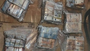 Five people were arrested over the cash seizures