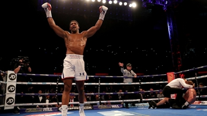 Anthony Joshua celebrates following a tough defence of his heavyweight title