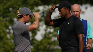 Rory McIlroy (L) and Tiger Woods will face off in Atlanta