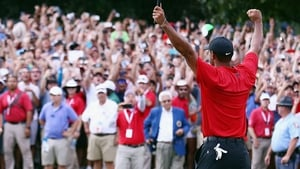 Tiger Woods salutes the crowd after clinching the Tour Championship title