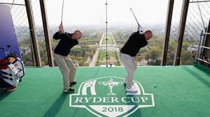 Elevated tee box - Ryder Cup captains Jim Furyk and Thomas Bjorn tee off from a platform on the Eiffel Tower