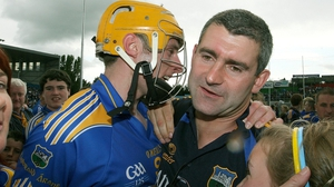 Shane McGrath and Liam Sheedy after Tipp's Munster triumph in 2009