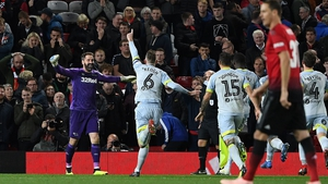 Richard Keogh leads the charge to celebrate with Scott Carson