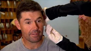 A sample of blood is taken from Padraig Harrington's earlobe