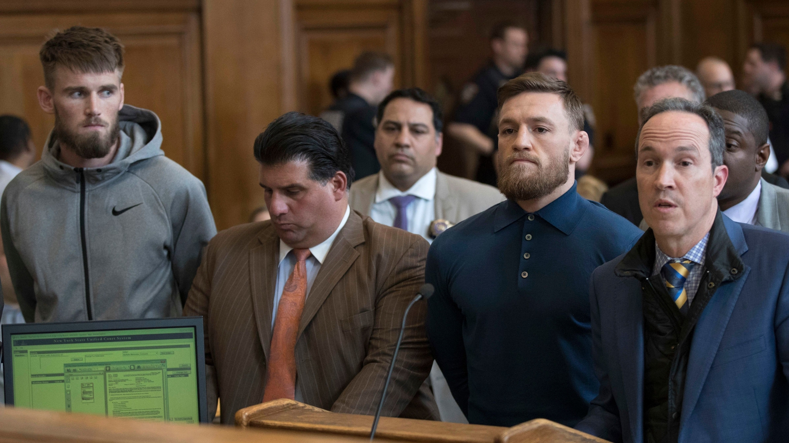 Image - McGregor next to his lawyer Jim Walden (R) in Brooklyn Criminal Court in April