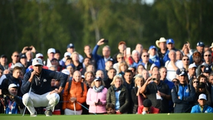 US golfer Brooks Koepka lines up a putt at Le Golf National Course