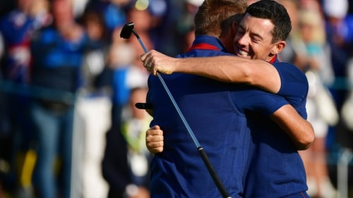 Rory McIlroy and Ian Poulter embrace in Paris