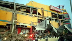 A handout photo of a collapsed shopping centre in Donggala