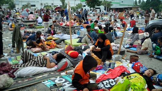 Rescue efforts continue following Indonesia's devastating  earthquake and tsunami