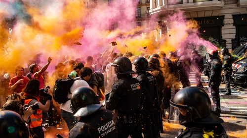 Separatist protesters threw powder paint at riot police