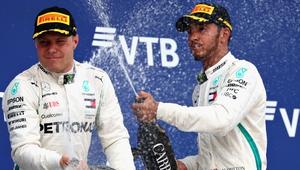 Lewis Hamilton (R) and Mercedes team-mate Valtteri Bottas celebrate on the podium