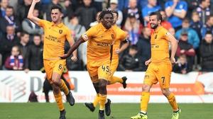 Dolly Menga of Livingston celebrates his goal