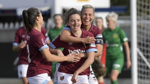 Leanne Kiernan (C) of West Ham United celebrates her goal