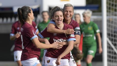 Leanne Kiernan (C) of West Ham United celebrates her goal
