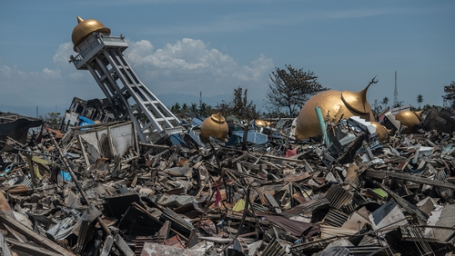 Rubble and debris lie around the ruins of a mosque in Palu