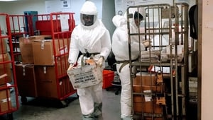 US Defense Department personnel, wearing protective suits, screen mail as it arrives at the Pentagon