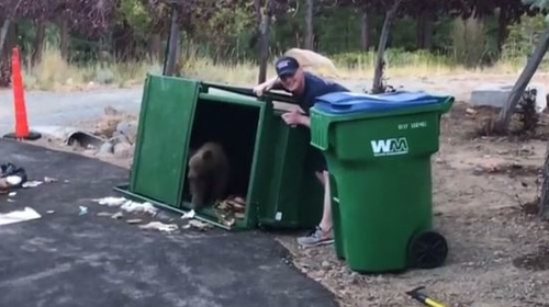 Paramedic Ed Martin lifted the bin open (Pic: Truckee Meadows Fire Protection District)