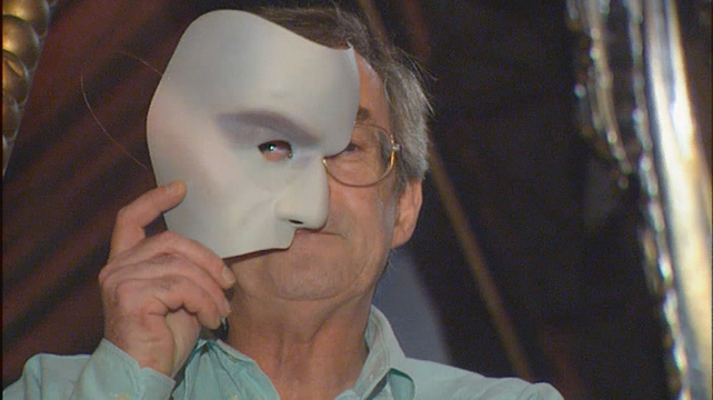 Reporter Colm Connolly wears the Phantom mask