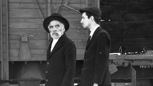 1945: two Jewish men, possibly father and son, arrive in a Hungarian village in the dead heat of August.