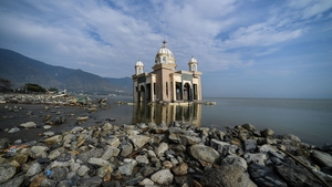 A mosque still standing amid the disaster
