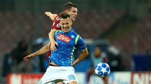 Arkadiusz Milik holds off Liverpool's James Milner