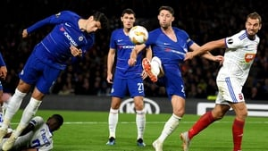 Alvaro Morata and Gary Cahill of Chelsea stretch for the ball