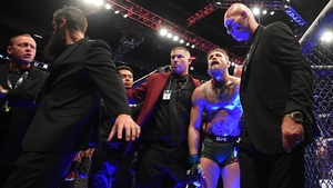 Conor McGregor is led from the octagon after the fight