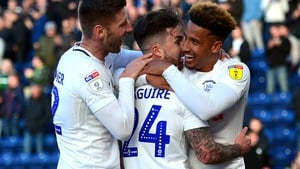 Sean Maguire celebrates with Callum Robinson