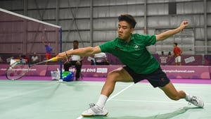 Nhat Nguyen on his way to an opening win in the badminton singles