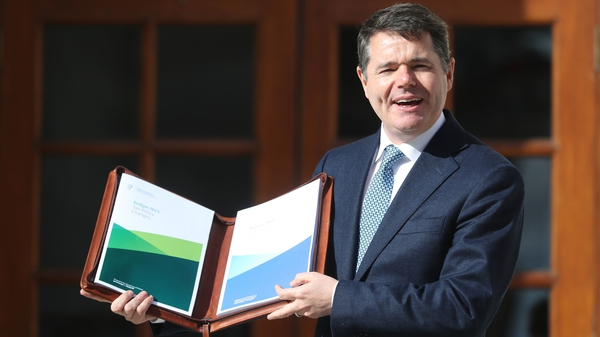 Minister for Finance Paschal Donohoe with the Budget document this afternoon