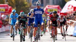 Ariel Maximiliano Richeze  (C) celebrates victory ahead of  Sam Bennett of Ireland (L) and Jean Pierre Drucker (R) of Luxembourg
