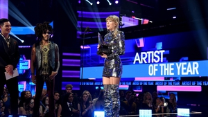 Taylor Swift accepts the award for Artist of the Year onstage during the 2018 American Music Awards