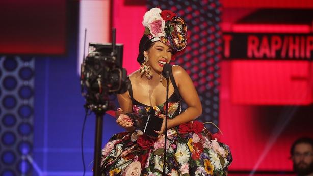 Cardi B accepts the Favorite Artist - Rap/Hip-Hop award onstage