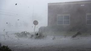 Debris is blown down a street by Hurricane Michael in Panama City, Florida