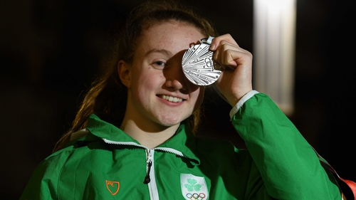 Niamh Coyne gets a good look at her silver medal.