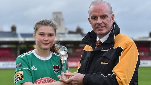 Éabha O'Mahony of Cork City is presented with the Player of the Month award for August by Tom Dennigan of Continental Tyres Group