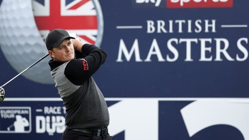 Eddie Pepperell hit a hole-in-one to grab a share of the British Masters lead