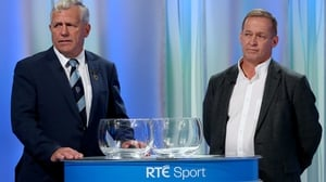 Clare manager Colm Collins (R) with Munster chairman Jerry O'Sullivan at last night's draw