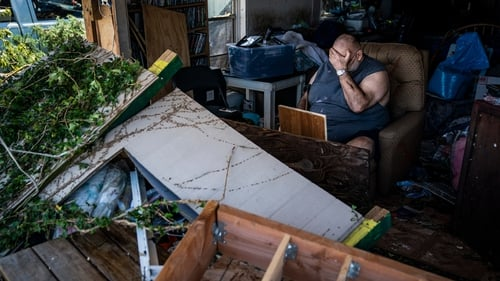Benny Hobson, 69, sits in what is left of his home in Panama City, Florida