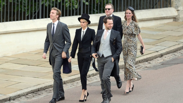 Cara Delevingne (centre) arrives for the wedding of Princess Eugenie to Jack Brooksbank (Aaron Chown/ PA)
