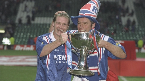Paul Gascoigne (left) and teammate Ally McCoist pose with the Scottish Coca Cola Cup trophy in 1996