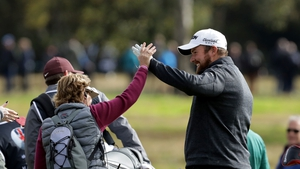 Lowry congratulated by spectator after his hole in one on the 5th hole