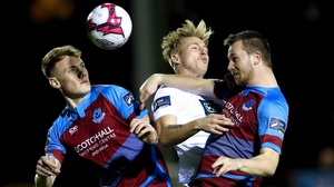 Drogheda's Ciarán Kelly and Luke Gallagher rise with Jesse Devers of Finn Harps