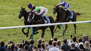 Seamie Heffernan riding Low Sun (pink, green cap) wins the Cesarewitch Stakes at Newmarket