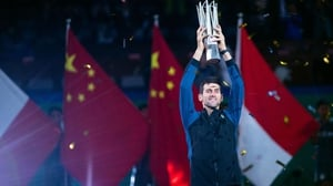 Novak Djokovic poses with his trophy after beating Borna Coric