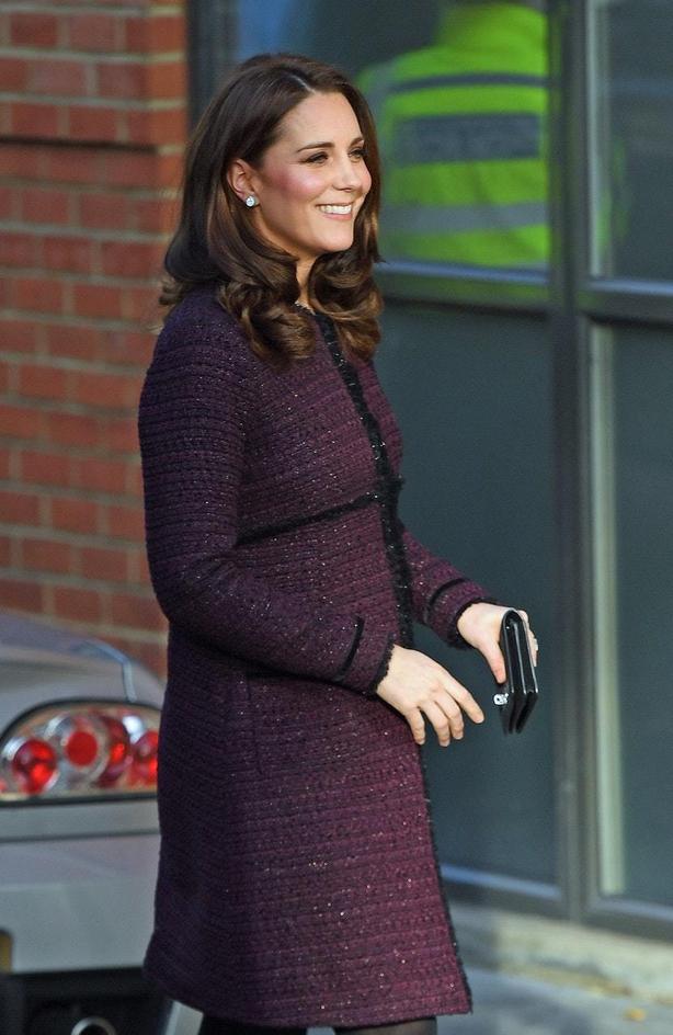 The Duchess of Cambridge wearing a Seraphine coat at the Rugby Portobello Trust community centre in North Kensington, London (Victoria JonesPA)