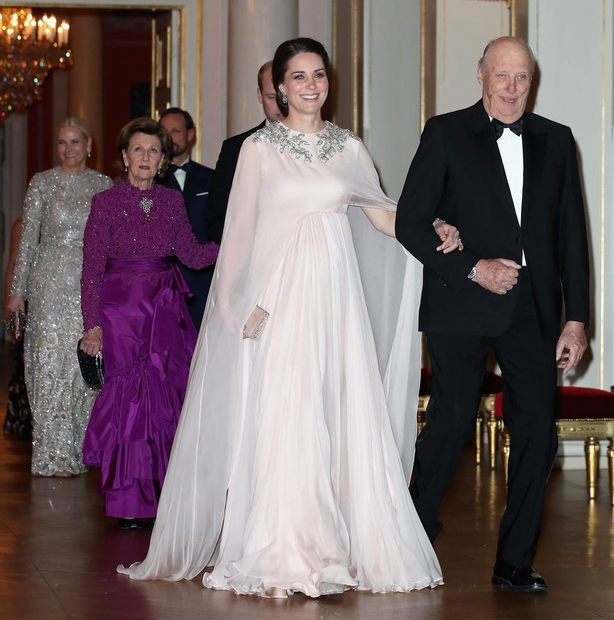 The Duchess of Cambridge is escorted into dinner by King Harald V of Norway at the Royal Palace, Oslo, Norway at the end of the third day of her tour of Scandinavia (Chris JacksonPA)