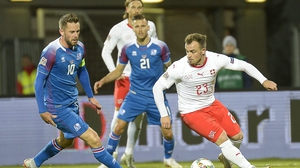Iceland's midfielder Gylfi Sigurdsson (L) tries to close down Switzerland's Xherdan Shaqiri